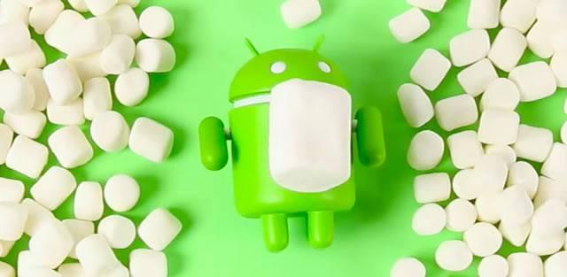 Зеленый робот Android Google в окружении зефирных пастилок