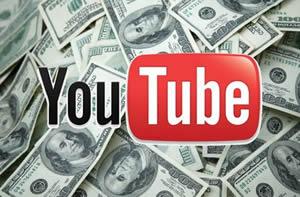 Эмблема YouTube в окружении денег