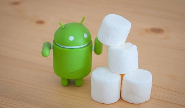 Зеленый робот Android строит пирамидку из зефира